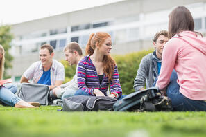 Group of college students sitting in the park